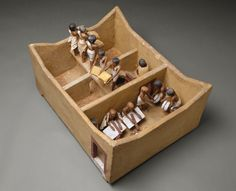 Model of a Granary with Scribes. Middle Kingdom, Dynasty 12, early reign of Amenemhat I (ca. 1981–1975 B.C.). Wood, plaster, paint, linen, grain; L. 74.9 (29 1/2 in.), W. 56 cm (22 1/16 in.), H. 36.5 (14 3/8 in.), average height of figures: 20 cm (7 7/8 in.). The Metropolitan Museum of Art, New York, Rogers Fund and Edward S. Harkness Gift, 1920 (20.3.11)