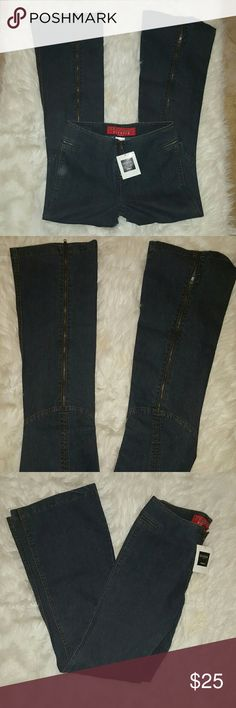 Nwt Guess jeans stretch , newest tags bootcut zippers in the back of the leg Zipper at waist line high-waisted size 28 Spandex and cotton and polyester blend Guess Jeans Boot Cut