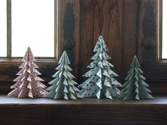 """DIY: Christmas trees by Søstrene Grene. """"Depending on the size of the paper, you can fold both little and big trees,"""" Anna says. The trees can be used as decoration in the windowsill or on the dinner table. Get more DIY ideas here: . Find the Origami Christmas Tree, Christmas Tree Crafts, Gold Christmas, Christmas Tree Decorations, Christmas Ornaments, Diy Christmas Star, Christmas Paper, Diy Origami, Origami Paper"""