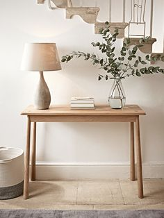 Slim and elegant in shape, our Scandinavian-inspired console table has slender, tapered legs to give a beautiful silhouette and will sit perfectly in your hallway or living room. Crafted from blonde mellow oak and flawlessly finished, it has a subtle wood grain, circular join details and rounded edges.