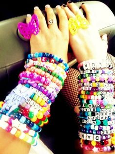 wearing a bunch of bead bracelets at once!