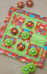 Tic tack toe board out of fabric and yo yo's ~ maybe as a part for a quiet book for older kids