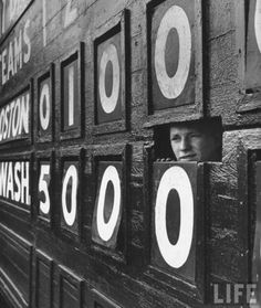 Boy running the scoreboard at Griffith Stadium. Washington, D.C. 1956.   Photo: Hank Walker