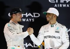 Nico Rosberg Photos Photos - Race winner Lewis Hamilton of Great Britain and Mercedes GP shakes hands with second place finisher and F1 World Drivers Champion Nico Rosberg of Germany and Mercedes GP on the podium during the Abu Dhabi Formula One Grand Prix at Yas Marina Circuit on November 27, 2016 in Abu Dhabi, United Arab Emirates. - F1 Grand Prix of Abu Dhabi