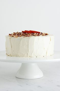 raw strawberry layer cake with rose frOsting
