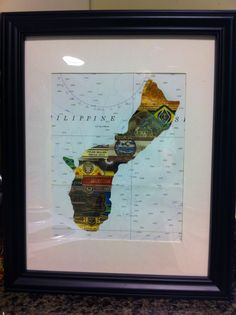 Guam out of cigar labels framed on nautical chart.  do this with other shapes.