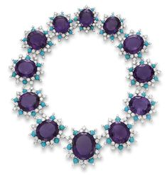 AN IMPRESSIVE AMETHYST, DIAMOND AND TURQUOISE NECKLACE, BY CARTIER     Designed as a series of graduated oval-cut amethysts, each within a circular-cut diamond and cabochon turquoise cluster surround, mounted in platinum, circa 1960