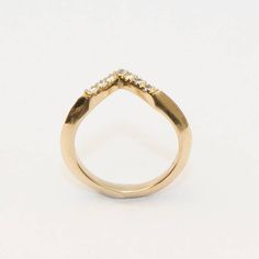 Are you interested in our angled gold wedding band? With our wedding gold diamond ring you need look no further.