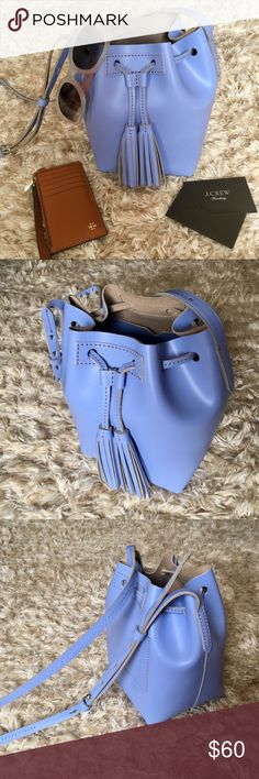 JCrew Bucket Bag NWOT Periwinkle blue bucket bag purchased from JCrew retail store, not factory store. NWOT. Never worn before. Perfect condition, no creases or scratches. Comes with a card with JCrew's care instructions. Adjustable straps. Refer to the last photo for more product details. J. Crew Bags Crossbody Bags
