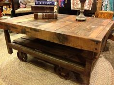Awesome coffee table my brother made unsing an industrial cart and walnut wood.  He has displayed at Urban Mining, Kansas City.