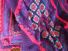 Crocheted Purple and Pink Granny Square Blanket.
