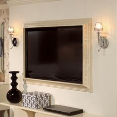 Frame a flat screen TV with crown molding... A little bit of elegance :)