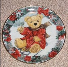 """""""Teddy's Winter Wonderland"""" Franklin Mint Heirloom designed plate by Sarah Bengry. Image of teddy bear with sleigh and Christmas motif.   Limited edition fine bone china with gold trim - plate number PD4573."""