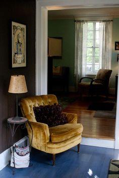 blue floor! brown wall, gold chair, white trim
