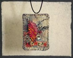 This is a boho fabric necklace with leaf motif. Its done with a lot of hand stitched careful work.