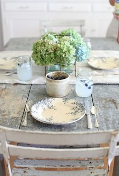 Your holiday table doesn't have to be all turkey and pumpkins. This one, with simple dried hydrangeas and vintage china, is a bit austere, but inviting nonetheless.