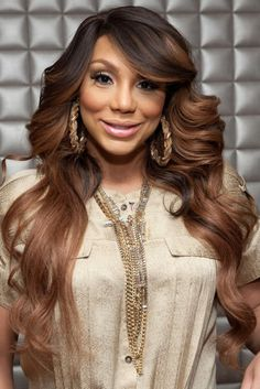 Tamar Braxton pulled a hue-switcheroo when she appeared on the show 106 & Park in these two-toned brown rippling waves. LOVE this color on TayTay!