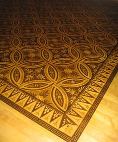 The intricacies of the wood inlays on this floor pattern takes my breath away. Definitely a dream floor for my dining room