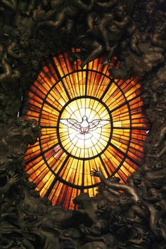The golden colored Holy Spirit stained glass window behind the altar in St. Peter's Cathedral in Rome. Stained Glass Tattoo, Stained Glass Art, Stained Glass Windows, Mosaic Glass, L'art Du Vitrail, Stained Glass Church, Saint Esprit, Church Windows, Glass Marbles