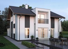 ELK Haus 153 mit Büro Anbau & Zwerchgiebel - ELK Fertighaus | HausbauDirekt Living Haus, Villa, My House, Architecture Design, House Plans, New Homes, Exterior, Windows, How To Plan