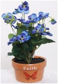Add a little springtime cheer to your home or office anytime of year with this colorful artificial potted pansy. This fun little plant stands in a terra cotta pot, featuring a butterfly design and the word Faith. Inside the pot, the plant stands in a base that looks like real potting soil.
