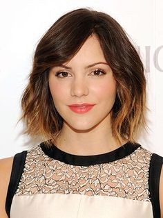 Dark brown hair with face-framing golden highlights