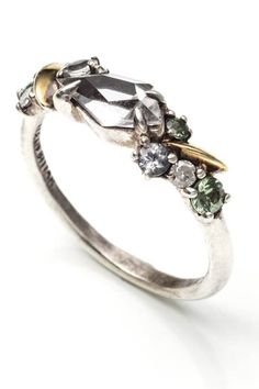 If you can't decide on a single stone you like best, choose a ring with many so that you never have to. Alexis Bittar Silver Gaze Marquis Large Cluster Band Ring, $495, available at Alexis Bittar.
