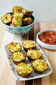 Baked Zucchini Bites (gluten free option) - great appetizer idea!  I'd probably make with a different, more flavorful cheese and also add a dash of hot sauce... (pepper jack for a Mexican spin?)