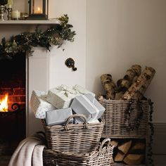 beautifully wrapped presents, candles, and a fireplace