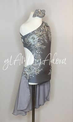Stunning grey/silver dance competition costume with 3D appliqués and Swarovski crystals.