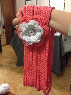 Crochet scarf with flower.