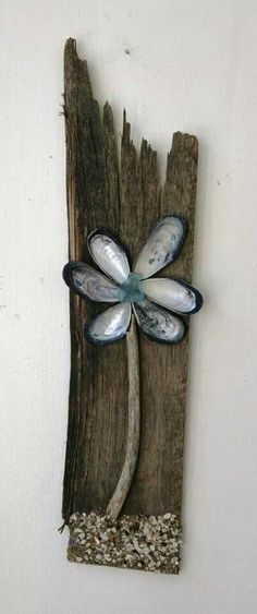 .Love this board with clam shells made into a flower!!!  Would look cute on our fence!