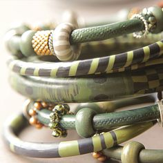 Like the skinny bangles with additions - green polymer bangles - Kim Otterbein Design