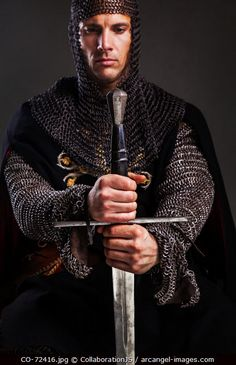 www.arcangel.com -knight--holding-his-sword-deep-in-thought