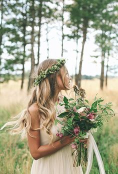 You can't go wrong with a romantic wreath of baby's breath for the wanderlust bride. Keep it simple with loose waves and a soft silhouette with floral accents of berry-hued roses and wild greenery.