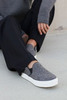 Mija is wearing felt slip-ons from Celine, grey turtleneck and wide leg trousers from Windsor