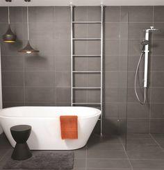 Love the grey tiles, metal ladder towel rail and freestanding bath