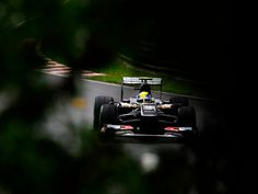 Peaking through the trees is Gutierrez's Sauber during practice for Montreal