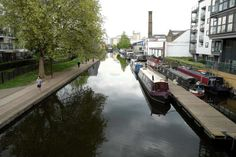 A view of Regents Canal and boats towards Sturts Lock near Sherpherdess Walk and City Road Islington London N1: 'I say hello to every coot on the way.' Regent's Canal in London. Photograph: Alamy