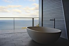 Apaiser's Haven Bath in 'The Lair'. This building, designed by Architect Rick Bzowy of Bzowy Architecture and located in Rocky Hills, Tasmania, cost 2.5 million dollars and  took 4 years to complete. This view from the bathroom shows the luxurious finishes that the Architect has chosen, with Apaiser's stone baths being a natural first choice to compliment the surroundings and high standard materials.