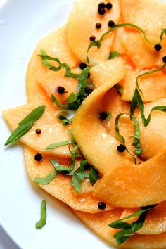 Cantaloupe is marinated in honey and spices, then tossed with basil and sea salt for this refreshing summer salad.