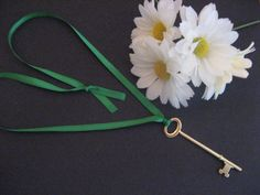 Key to the Girl Scout Daisy Flower Garden. Keepsake or SWAP. Made with a skeleton key from local home improvement store and ribbon.