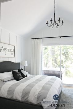 The 4 Best White Paint Colours: Sherwin Williams. Learn about Extra White, Alabaster, Pure White and High Reflective White. Shown in bedroom with board and batten, farmhouse style black chandelier with vaulted ceiling. Wooden sign and gray, white and black decor. Kylie M Interiors Edesign, online paint colour expert #edesign #whitewalls #farmhousebedroom #whitebedroom #sherwinwilliams #kylieminteriors #kyliemedesign #colourexpert