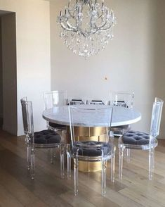Ghost dining chairs with marble table