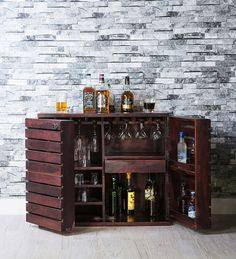 Pepperfry's wine holders work as aesthetic artworks to display your collection. They do not require a horde of bottles to look stylish. You will get a range of wine rack designs to choose from. Choose them according to your tastes and interiors. Go for the wooden wine racks which will offer durability along with style.