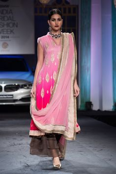 Ombre pink Indian wedding suit lehnga by Meera Muzaffar Ali at India Bridal Fashion Week 2014. More here: http://www.indianweddingsite.com/bmw-india-bridal-fashion-week-ibfw-2014-meera-muzaffar-ali/