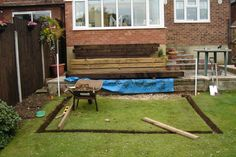 Lee neighbour's koi pond with new pine railway sleepers - initial preparation.