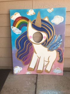This shiny unicorn photo op is a must at your unicorn themed celebration! Party guests of all ages will love to pose in this photo-op. This has been painted by hand onto a 40x32 inch foam board. The wings, hair, clouds and rainbow are loaded with colorful sparkly glitter and the unicorn is outlines in metallic gold paint for even more shine. Please include your party date when ordering. Thank you