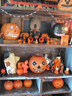 Vintage halloween decor in old antique cupboard.