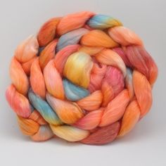 "Merino Tencel Roving Hand dyed  ""Coral"" combed top. $17.50, via Etsy."